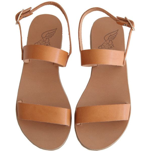 "Clio sandals from Ancient Greek Sandals. These leather sandals feature an open toe, two strap sandal, thin leather sole with rubber non-slip heel, and metal ""w…"