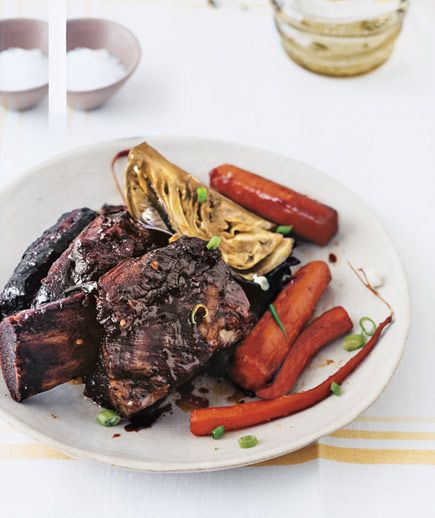 Slow Cooker Asian Short Ribs are sure to impress and super simple to make in your slow cooker. #CrockPot #SlowCooker #recipe