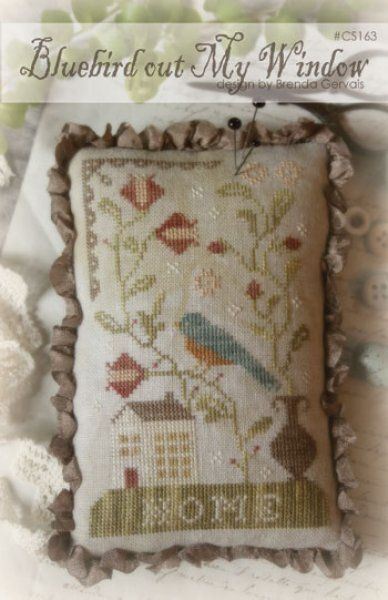 Bluebird Out My Window is the title of this cross stitch pattern from With Thy Needle and Thread featuring a blue bird and home that is stitched with Weeks Dye Works (Light Khaki, Beige, Peach, Cocoa and Cadet)