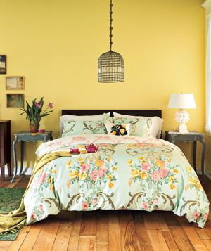 comforter + beautiful yellow wall + antique-looking furniture and feel = cute room