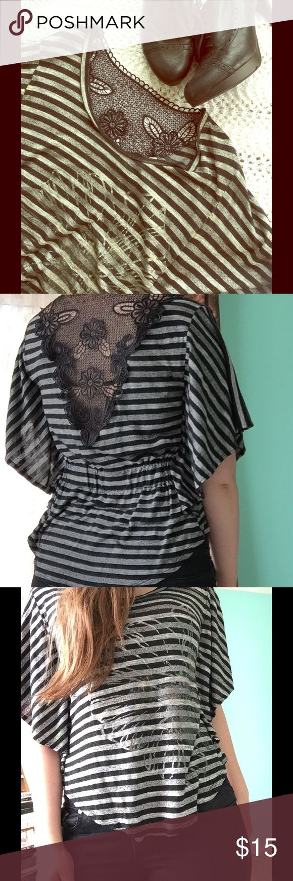 Striped Batwing Flower Shirt Chic black & gray striped batwing shirt with silver flower on front and beautiful lace back. Back is also gathered with elastic. Used but in near perfect condition, only flaw is a very small, barely noticeable pink spot near right side of collar (visible in first pic). Size M. Urban Episode Tops