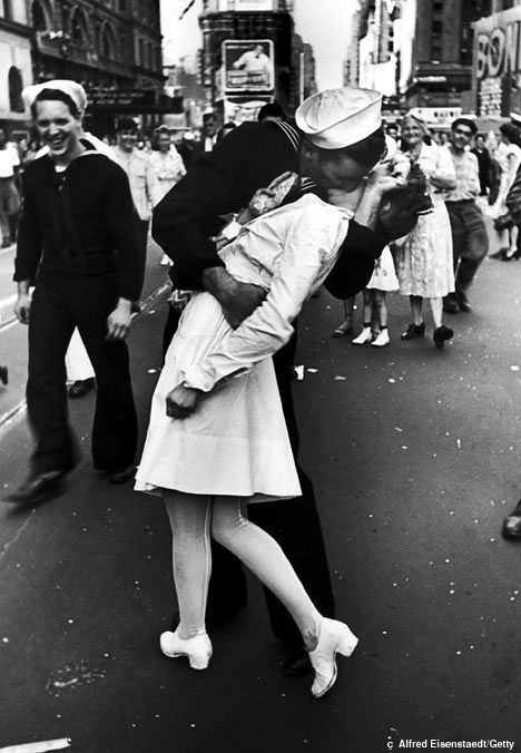 """This photograph, """"The Kiss"""", is one of the most famous photos ever taken. It was taken by Alfred Eisenstaedt in Times Square in New York City in 1945 on VJ Day (Victory of Japan Day) when Japan surrendered during WWII. This photograph depicts how love triumphs over war."""