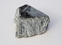 Zinc, in commerce also spelter, is a metallic chemical element; it has the symbol Zn and atomic number 30. It is the first element of group 12 of the periodic table. Zinc is, in some respects, chemically similar to magnesium, because its ion is of similar size and its only common oxidation state is +2. Zinc is the 24th most abundant element in the Earth's crust and has five stable isotopes. The most common zinc ore is sphalerite (zinc blende), a zinc sulfide mineral.