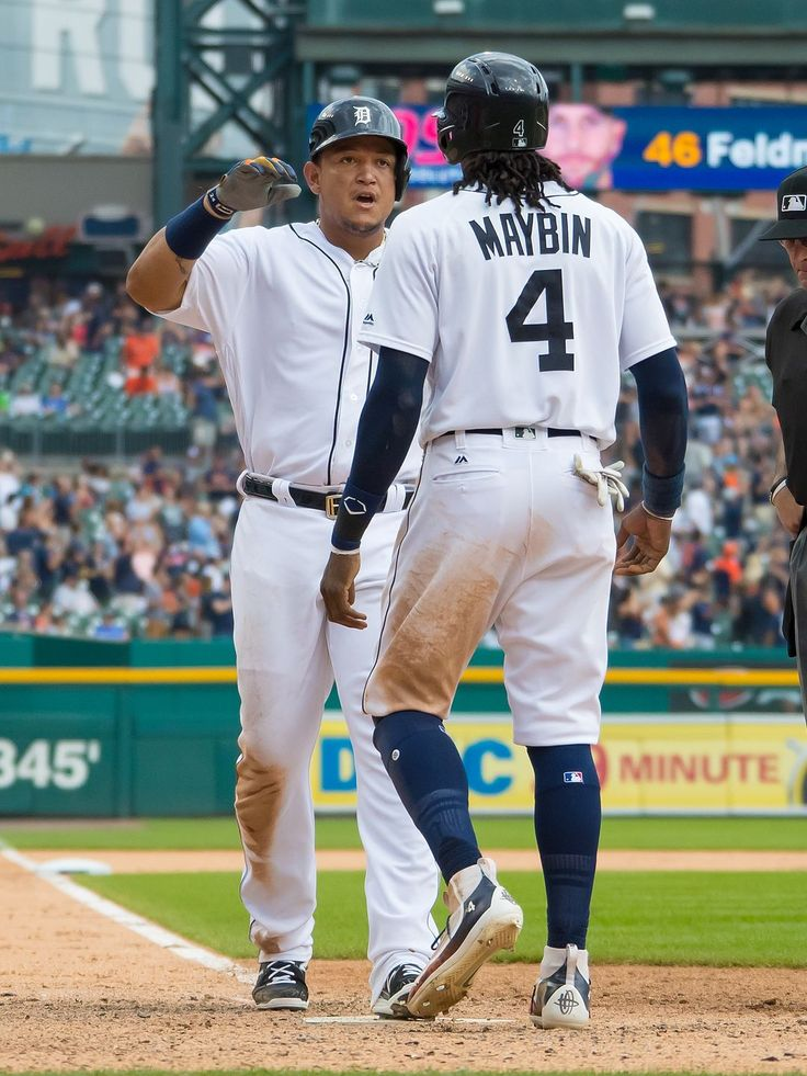Miguel Cabrera celebrates with Cameron Maybin after hitting a two-run home run in the seventh inning, 07/31/2106