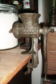 Antique meat grinder.  This was a staple in our home. Nan & Mum both used it, and sometimes my Dad, did, too. Any lamb left over from Sunday's leg of lamb roast would be minced up on Monday, and made into a firm favorite - Shepherd's Pie. I got to help with the mincer quite a bit.