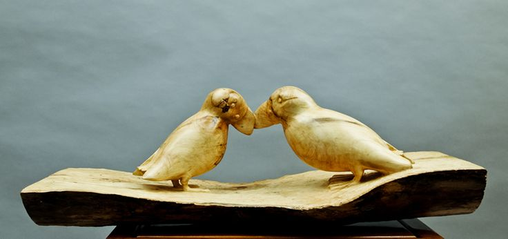 Puffin love sculpture in wood by Chris Sherratt. Sculpted in sycamore wood