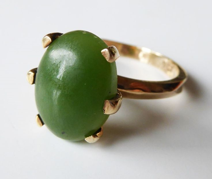 Gorgeous ring set with a chunky dark greenstone. Thick band. Stamped 9ct as in pics. Vintage piece. 17 mm inside diameter. 14 mm stone. Listing some solid gold jewellery today 9ct and 14 ct.
