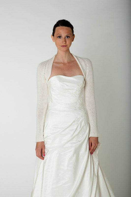 Bridal jacket for colder seasons. It warms in church, outside, at the sea or for wedding receptions. It is a classical pattern suiting elegant wedding dresses perfectly.  All available colours are shown on the cardigan product with knots. Please quote your chosen colour in the field notes when ordering.   This sleeve Bolero is a little peace of art. Manufactured in Germany.  *Merino/Cashmere*; pic 1 & 2, Ivory pic 3: White; pic 4: rose, pic 5: lilac  MATERIAL  BABY ALPACA: 70% baby a...