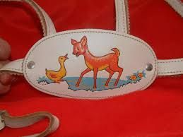 These used to clip into your big posh prams too, kinda like a seat belt