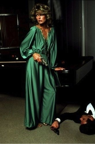1978: Farrah Fawcett-Majors in Yves Saint Laurent, photographed by Helmut Newton (surely Newton had something to do with The Eyes of Laura Mars?).