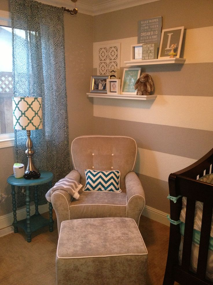 "The walls. I love the walls in this nursery. The colors are gender neutral too so it could work for a girl or a boy :)  ""I painted one wall of my son's nautical nursery striped like this, then the other three walls in the same lighter shade of the stripes. It was time consuming but I could DIY it and it turned out amazing!"" -Amanda"