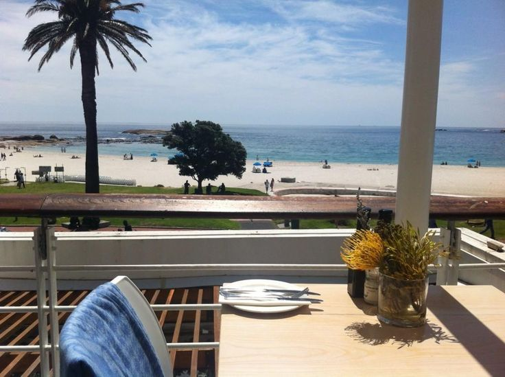 It's a beautiful (windless) day for a cocktail in Camps Bay. The view from @BLUESRestaurant