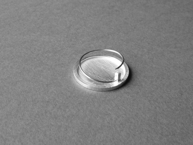 Circular pin - the end goes into the top hole