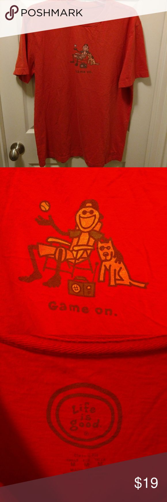 "LIFE IS GOOD "" GAME ON"" TSHIRT LIFE IS GOOD MEN'S TSHIRT. ""GAME ON""  SIZE MEDIUM ARMPIT TO ARMPIT: 21"" COLLAR TO BASE: 28""  VERY GOOD CONDITION WITH NO RIPS TEARS OR STAINS  #607 Life is Good Shirts Tees - Short Sleeve"