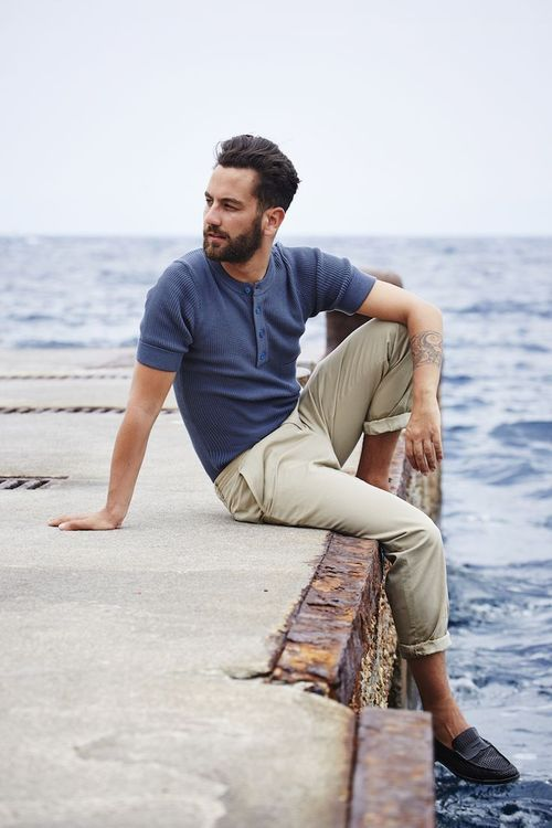 Reach for a navy polo and beige chinos for a trendy and easy going look. Throw in a pair of black leather loafers to show your sartorial savvy.  Shop this look for $105:  http://lookastic.com/men/looks/beige-chinos-navy-polo-black-leather-loafers/4628  — Beige Chinos  — Navy Polo  — Black Leather Loafers