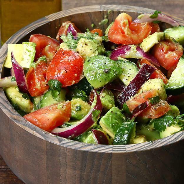 Enjoy This Healthy Cucumber, Tomato, And Avocado Salad- lemon, EVOO, cilantro, salt & pepper
