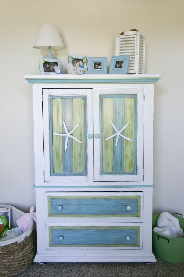 This armoire looks like a lot of work- but green and blue? I think they could go with yellow...