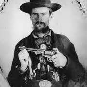 John Jarrette joined William Clarke Quantrill's guerrillas in October 1861. He was with Quantrill during the raid on Lawrence, Kansas, on August 21, 1863, and with William Anderson during the massacre at Centralia, Missouri, on September 27, 1864. After the war, Jarrette joined the Jesse James gang, and was a suspect in the robbery of the bank at Russellville, Kentucky, on March 21, 1868. In this photograph, Jarrette sports a captured Union waistbelt plate.