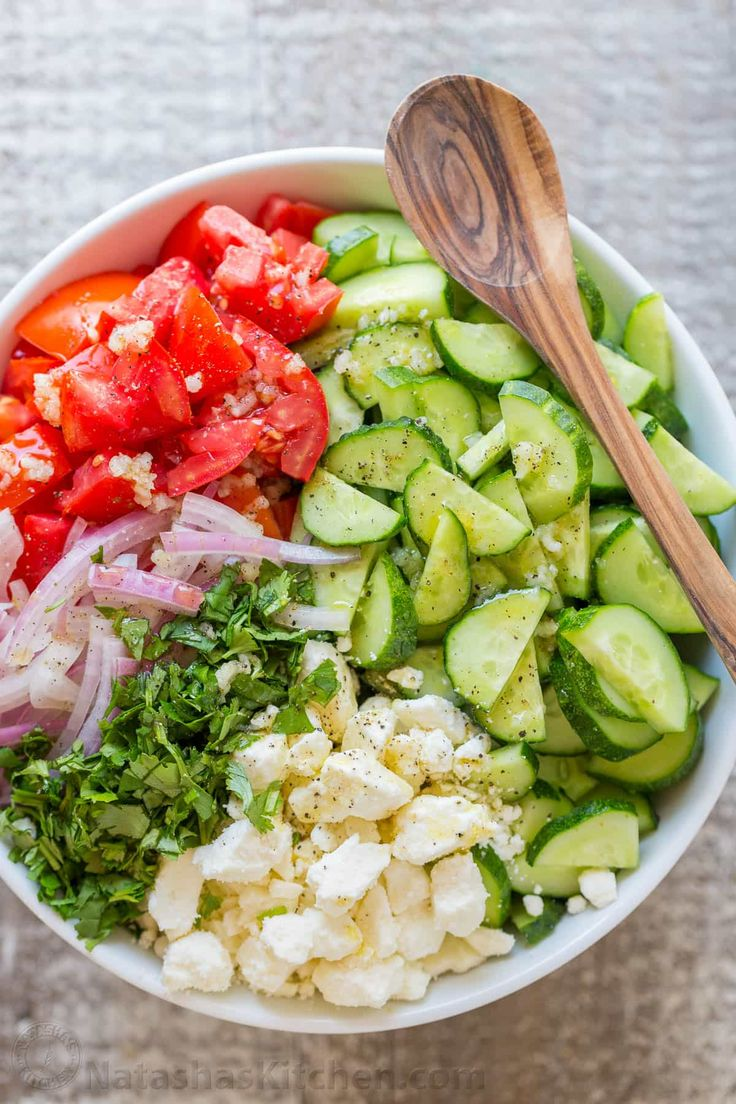 This Cucumber Tomato Feta Salad has simple ingredients that are a winning combination. Refreshing and flavorful! A new favorite cucumber tomato feta salad! | natashaskitchen.com