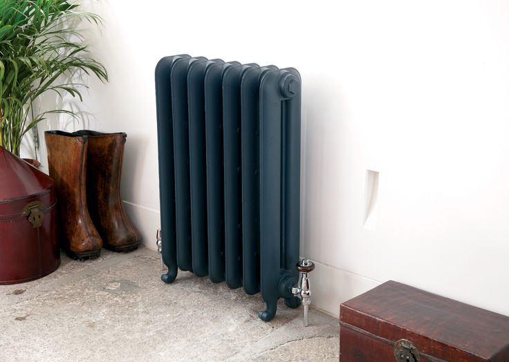 Gladstone cast iron radiator from Feature Radiators in Farrow Ball Hague Blue with Kingsley thermostatic valves in chrome