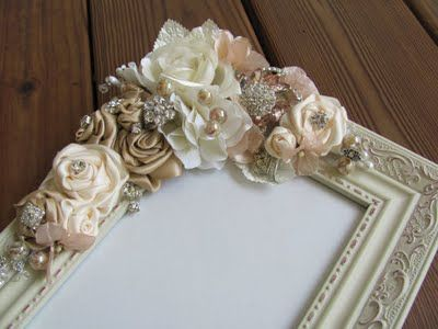 fabric flowers on picture frame - would make a nice wedding present if you could get fabric scraps from the making of the bridesmaid dresses!