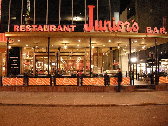 Juniors Midtown just off TimeSquare. Delicious food, straight-up casual, OUTSTANDING cheesecake, friendly bartenders, reasonably priced, . . . and a take-home bakery next door!