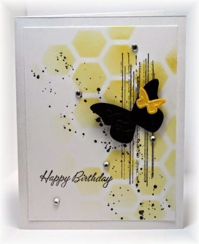 The card - I used a framelits die from SU as a stencil and sponged the background (hexagons).  Then I added some splotchy stuff from SU's gorgeous grunge.  A butterfly, sentiment and bling finished it off.  Colors are daffodil and black.