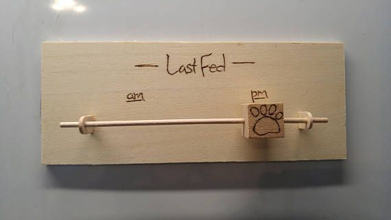 This cute sign functions as a reminder to help you keep track of feeding times. The sliding block moves easily to let yourself or family members that the dog has been fed. Hangs easily with small brad nails above your dogs food bowls or wherever convenient for your family. Please