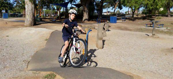 Kid riding his 510MTB kids mountain bike at local playground.