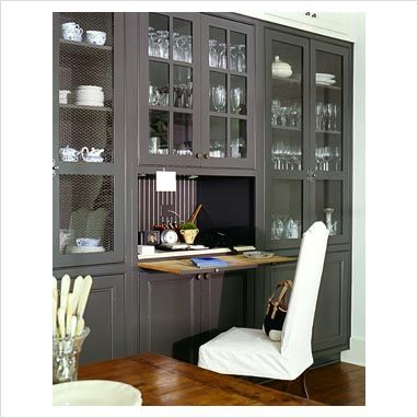 Built in bookcases in the homeschool room with hidden desk for kids
