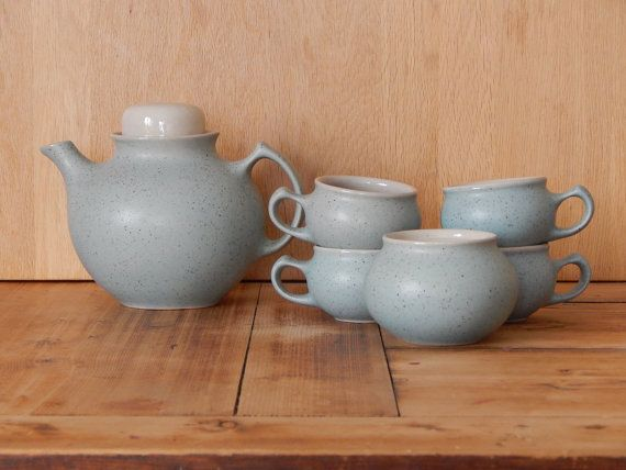 This stylish tea set is made in Scandinavian era, would be perfect for your eavning tea, or on its own as a decorative object. Set includes 4 tea cups, 1 teapot with lid, 1 sugar bowl.   Condition: excellent vintage condition, no cracks. Measures: Teapot Stands up 15 cm ( ca 6) Cups stands up 5 cm (2) Sugar bowl stands up 7 cm (2 3/4)   Please ask me for shipping price to your country