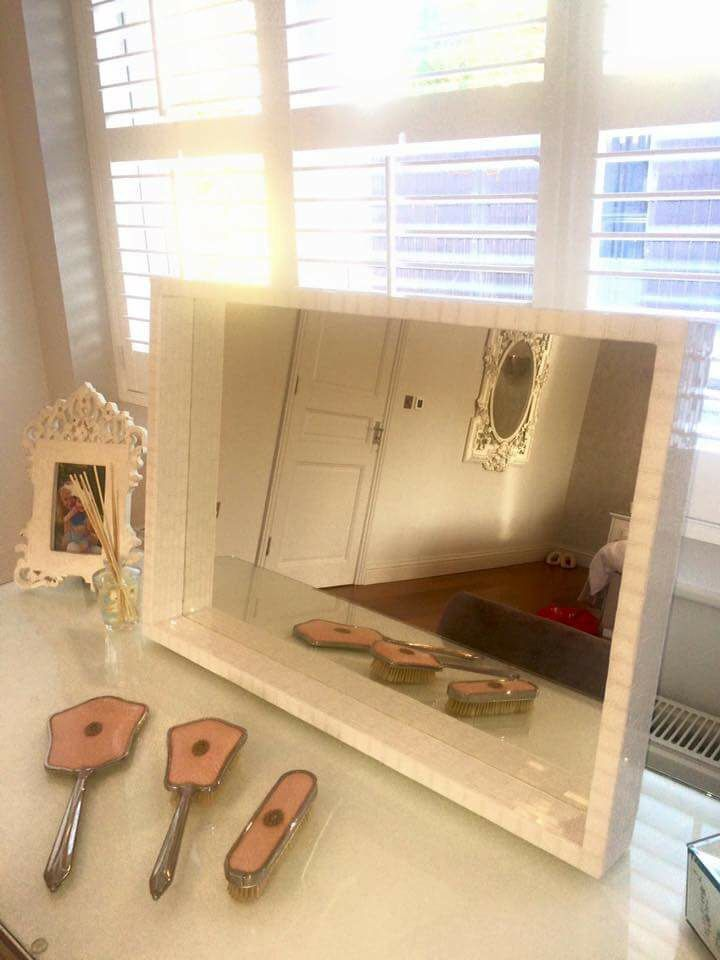 Dressing table mirror with white opaque glass.