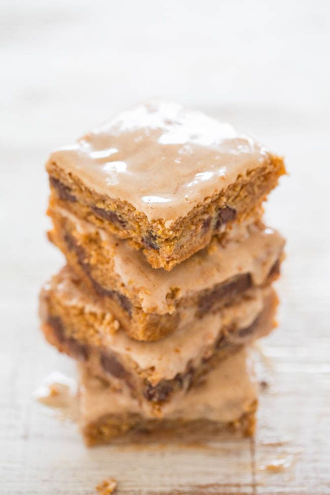 Pumpkin Chocolate Chip Gooey Bars - Incredibly gooey, soft, and chewy bars bursting with PUMPKIN and CHOCOLATE in every bite!! The vanilla spiced glaze complements these EASY bars just perfectly!!