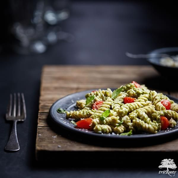 This Creamy Avocado Pesto Pasta is a delicious recipe for Meatless Monday. Cook truRoots®️ Ancient Grains Organic Fusilli. Then in a food processor, blend together avocado, pesto sauce and lemon juice until smooth. Combine the sauce with Romano cheese and pasta. Top with cherry tomatoes, cheese and basil!