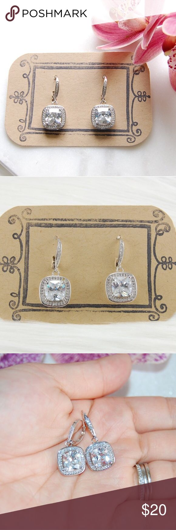 Dangling CZ Earrings | Cushion Cut Beyond stunning cushion cut cubic zirconia earrings. Perfect for any occasion! Large CZ is 4.4 karats and is surrounded by more CZs. French clip clasp (for pierced ears) also has a line of CZs. Hangs about an inch long. Dangling portion is 12mm x 12mm. Lead free. Includes box. Price firm unless bundled. {E3340}   Instagram: @bringingupsuns Jewelry Earrings