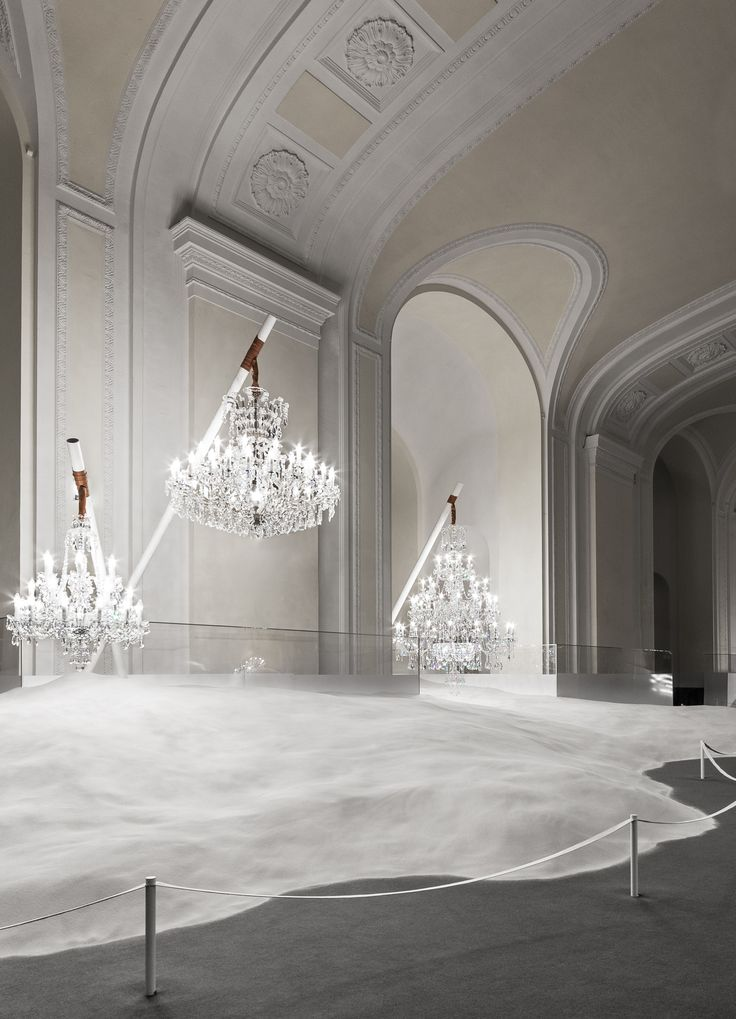 Discover what's Behind Locked Doors - the Red Dot award-winning public installation designed by Vasku&Klug. #crystal #chandelier #sand #preciosa #lighting #experience #history #atmosphere