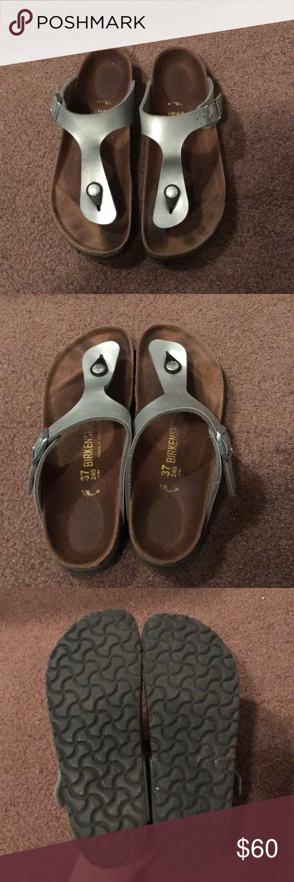 BIRKENSTOCKS!! Super cute Birkenstock Gizeh. Silver with black. Slightly worn, but I'm good condition as birks last forever! Comfiest shoes I've ever owned. Size 37 but I wes a 7-8 usually and these fit good. Birkenstock Shoes