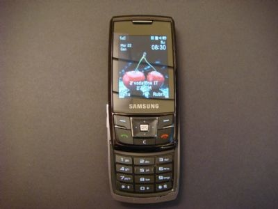 The Samsung D900i Metallic Silver mobile phone is a boldly-coloured version of a phone that already stands out, thanks to its ultra-slim 13mm depth. In fact, it's been described as 'the world's slimmest slider'.The Samsung D900i mobile phone is the latest design and more up to date version of the D900. At just , the D900i is even thinner than the D900 but still packs in a 3 mega-pixel to take your favourite snap shots, Bluetooth technology to transfer images and videos plus WAP browse.