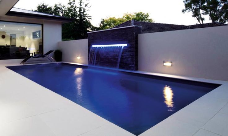 Wow. Reflection style fiberglass pool with very large sheer descent water…