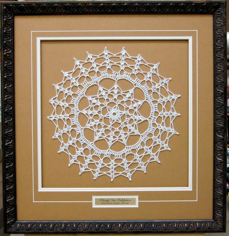 "Doily framed with a name plate. Great to remember why this piece is significant. Love how the ""V"" groove pulls it all together and how the mat is set up to add depth. Framed by Frameworks of Utah."