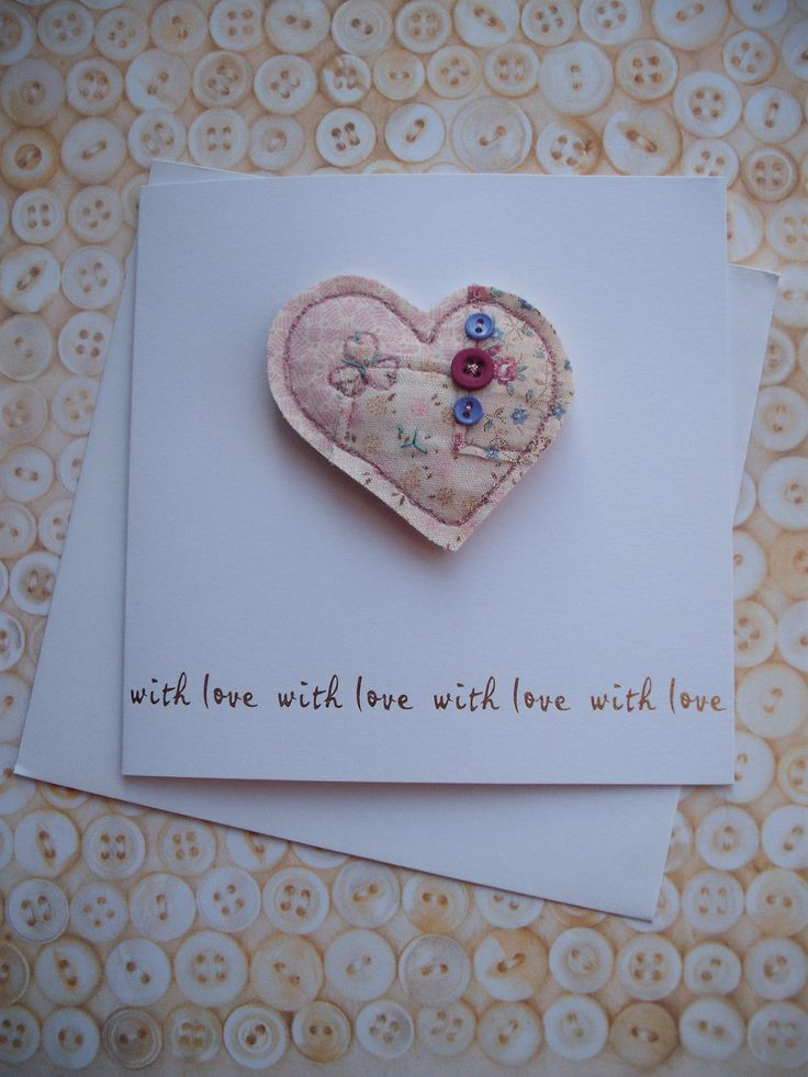 With love card with a machine and hand embroidered heart pin.