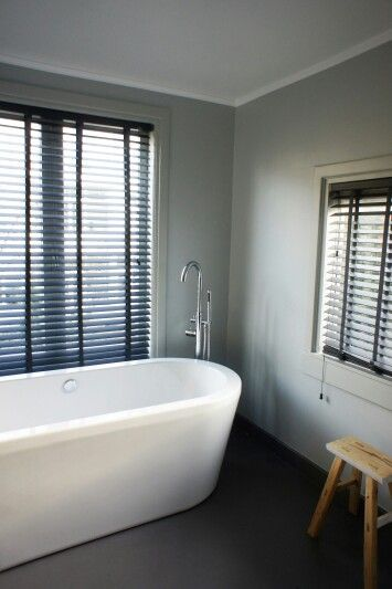 Bathroom in subtle grey via www.maisonlapin.nl