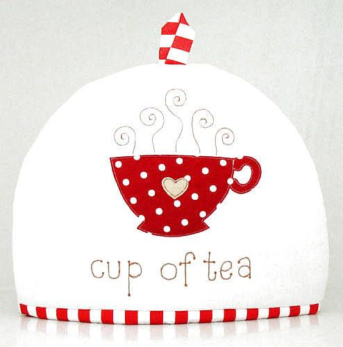 This gorgeous linen tea cosy is embroidered with the words 'cup of tea' and a polka-dot teacup. Go on, put the kettle on.Available in red/ivory or natural/brown.Linen with cotton details. Luxuriously padded.H24cm x W34cm (not including loop).