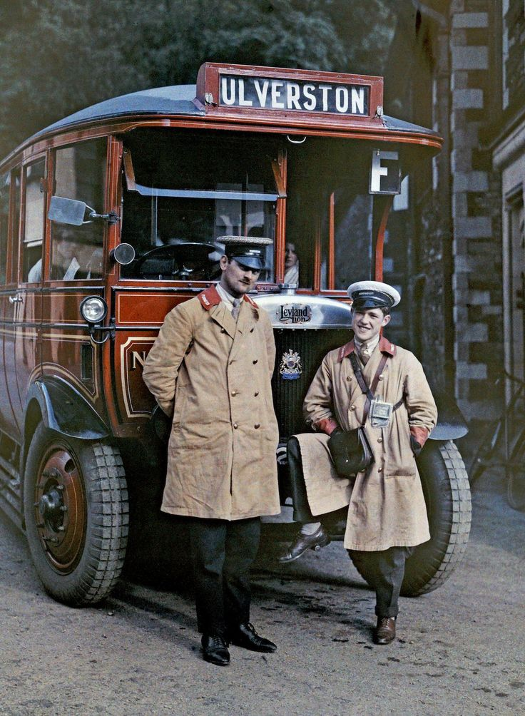 Two bus drivers stand in front of a tour bus in Ulverston, Cumbria. Image: Clifton R. Adams/National Geographic Creative/Corbis