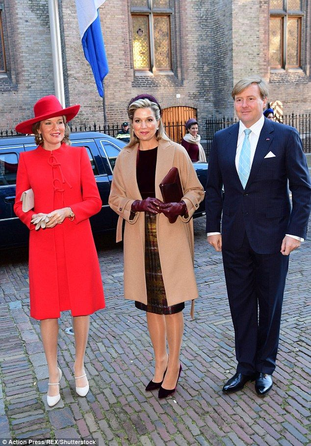 Once outside, the pair posed for more photographs alongside their husbands, King Philippe ...