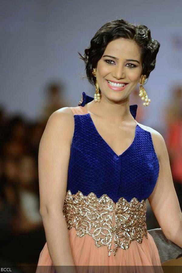 Poonam Pandey walks the ramp for designer Dinesh Malkani during ABIL Pune Fashion Week, held in Pune