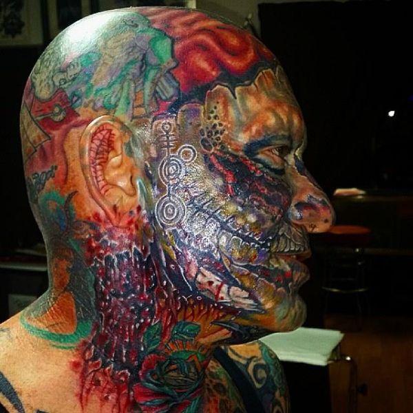 Inclined believe full facial tattoo Super Hero