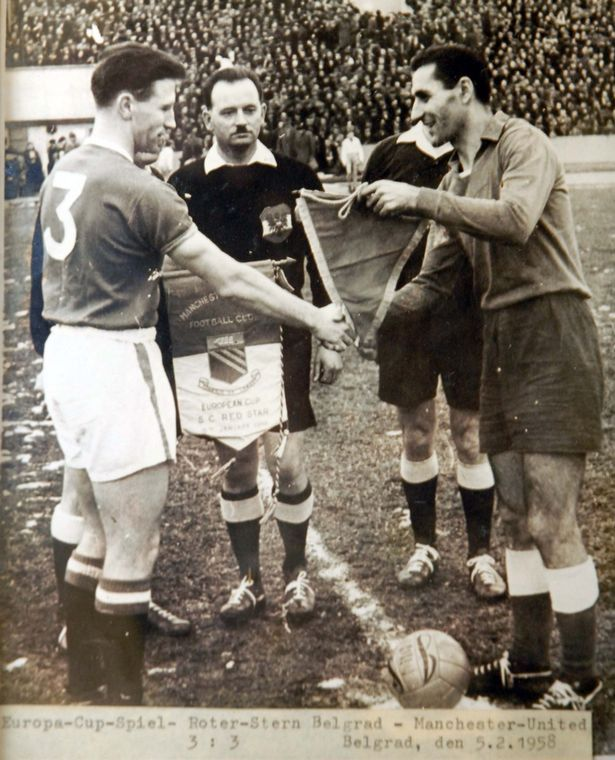Reds captain Roger Byrne exchanges pennants with his opposite number ahead of the game between United and Red Star Belgrade