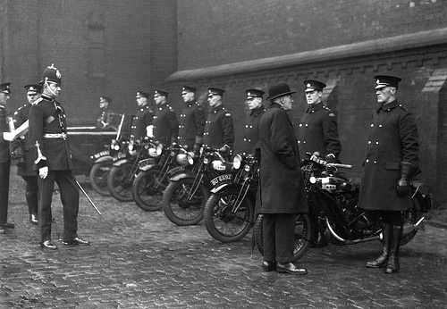 Oldham Motocycle Inspection The Chief Constable of Oldham Borough Police looks somewhat out of his time as he watches an inspection of the force's motorcyclists while wearing spurs and carrying a sword. From the collection of the Greater Manchester Police Museum and Archives. To find out more please visit http://www.gmpmuseum.com