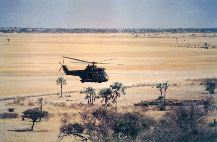 """An Oryx helicopter flying over Ovamboland in the now Namibia. The conflict on the border between Namibia and mainly Angola was known in South Africa as the Border War and went on from 1966 till 1988. Troops on the ground also called it the """"Buch War"""" or just the """"Border"""" or """"Grens"""""""